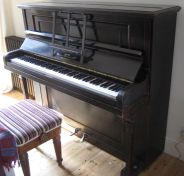 Yamaha P150 installed in vintage upright piano case